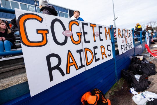 Signs supporting Almont are hung around the stadium at Walled Lake Central before the MHSAA Division 5 state semifinal against Detroit Denby Saturday, Nov. 23, 2019.