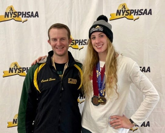 Roosevelt's Catherine Graham poses alongside her coach, Sean Ryan, after taking third in the 100-yard breaststroke at the state swimming championships on Saturday.