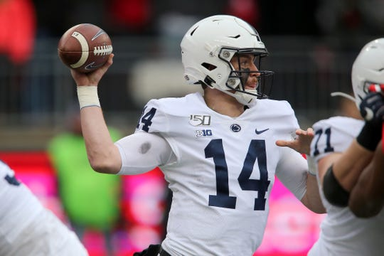 Nov 23, 2019; Columbus, OH, USA; Penn State Nittany Lions quarterback Sean Clifford (14) drops to throw during the first quarter against the Ohio State Buckeyes at Ohio Stadium. Mandatory Credit: Joe Maiorana-USA TODAY Sports