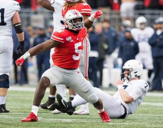 Nov 23, 2019; Columbus, OH, USA; Ohio State Buckeyes linebacker Baron Browning (5) celebrates after pressuring Penn State Nittany Lions quarterback Will Levis (7) into an incomplete pass in the second half at Ohio Stadium. Mandatory Credit: Greg Bartram-USA TODAY Sports