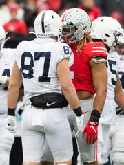Nov 23, 2019; Columbus, OH, USA; Ohio State Buckeyes defensive end Chase Young (2) has words with Penn State Nittany Lions tight end Pat Freiermuth (87) at Ohio Stadium. Mandatory Credit: Greg Bartram-USA TODAY Sports
