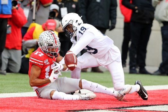 Nov 23, 2019; Columbus, OH, USA; Ohio State Buckeyes wide receiver Chris Olave (17) has the touchdown pass broken up by Penn State Nittany Lions cornerback Trent Gordon (19)during the second quarter at Ohio Stadium. Mandatory Credit: Joe Maiorana-USA TODAY Sports