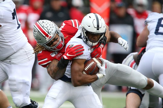 Nov 23, 2019; Columbus, OH, USA; Penn State Nittany Lions running back Journey Brown (4) tackled by Ohio State Buckeyes defensive end Chase Young (2) during the third quarter at Ohio Stadium. Mandatory Credit: Joe Maiorana-USA TODAY Sports