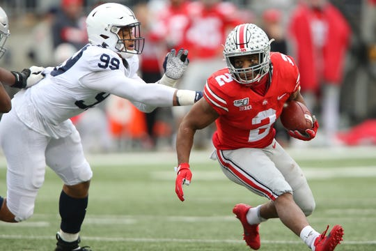 Nov 23, 2019; Columbus, OH, USA; Ohio State Buckeyes running back J.K. Dobbins (2) runs around the left side as Penn State Nittany Lions defensive end Yetur Gross-Matos (99) pursues during the second quarter at Ohio Stadium. Mandatory Credit: Joe Maiorana-USA TODAY Sports