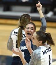 Nevada's Kaila Spevak, center, celebrates a point against Wyoming at the Virginia Street Gym.