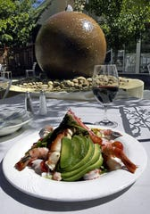 The Louie-Louie seafood salad, shown here in 2003 in the courtyard of the Grill at Quail Corners, still is on the menu in 2019.