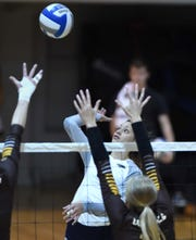 Nevada's Kayla Afoa goes up for the kill against Wyoming at the Virginia Street Gym on Thursday.