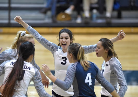 Nevada's Dalyn Burns celebrates a point against Wyoming at the Virginia Street Gym on Thursday.
