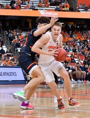 Syracuse Orange guard Buddy Boeheim (35) drives the lane as Bucknell Bison forward Kahliel Spear (23) defends in the second half at the Carrier Dome. Boeheim scored a career-high 22 points as Syracuse won 97-46.