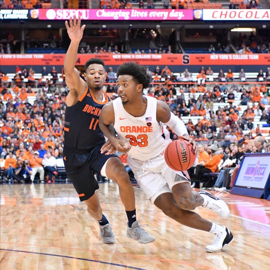Syracuse Orange forward Elijah Hughes (33) drives the ball past Bucknell Bison guard Avi Toomer (11) in the second half at the Carrier Dome. Hughes scored 21 points as Syracuse won 97-46.