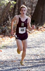 Sam Lawler from Pittsford Mendon High School races toward the finish line, in the boys New York State Federation Cross-Country Championships at Bowdoin Park in Wappingers Falls, Nov. 23, 2019.  Lawler won the race in 15:57.2.