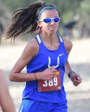 Grace Gaddy seen running at a meet in Redding in October 2019 won Athlete of the Week honors after finishing first in the CIF Northern Section cross country meet.