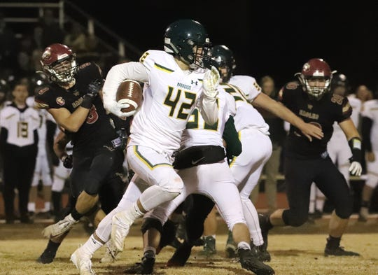 Paradise running back Tyler Harrison runs with the ball against West Valley in their semifinal playoff game on Friday, Nov. 22, 2019. Paradise advanced to the championship round with a 28-13 victory over West Valley.