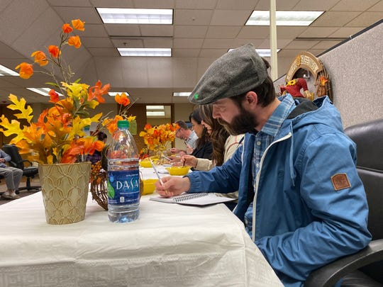 Shasta College culinary instructor Ryan Manley judges Mimi Moseley's winning pumpkin soup recipe at the Record Searchlight's North State Cooks contest in this Friday, Nov. 22, 2019 picture.