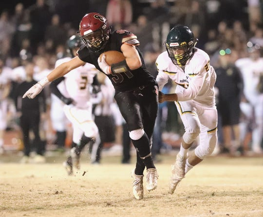 West Valley's Wyatt Reginato tries to elude a Paradise player in their semifinal playoff game Friday, Nov. 22, 2019. Paradise won 28-13.