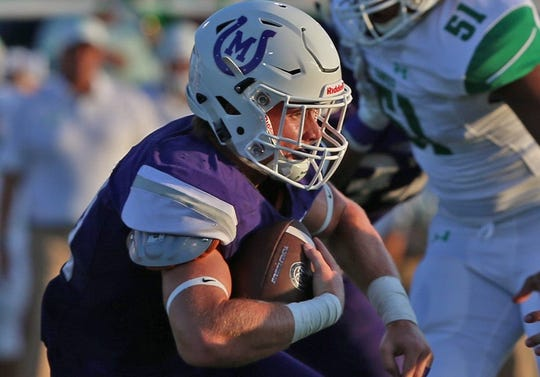 Mason High School's Klay Klaerner rushes the ball during the 2019 season.
