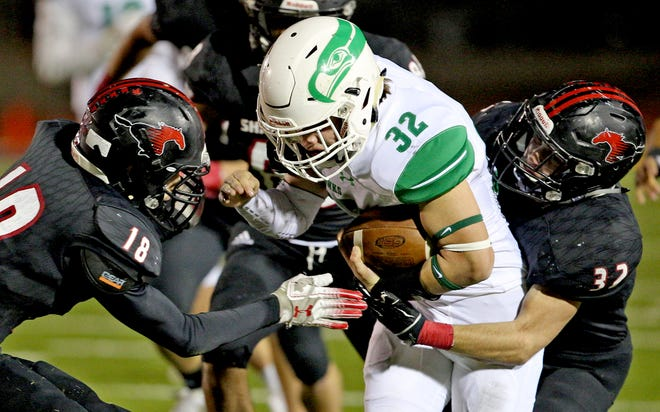 Dominic Garcia, center, is tackled after a run for Wall on Friday, Nov. 22, 2019.