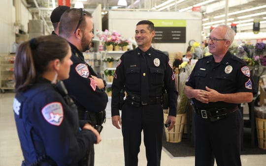 San Angelo Police Department officers wait to pick up Thanksgiving Day meals at H-E-B to deliver to families in need Saturday, Nov. 23, 2019.