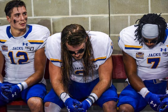 SDSU football players wait on the sidelines during the game against USD on Saturday, Nov. 23, 2019, at the DakotaDome in Vermillion. USD beat out SDSU with a final score of 24-21.