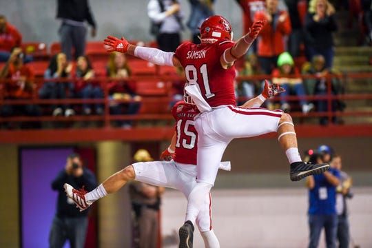 USD tight end Brett Samson (81) and USD wide receiver Drew Greenhaw (15) celebrate a touchdown during the game against SDSU on Saturday, Nov. 23, 2019, at the DakotaDome in Vermillion.