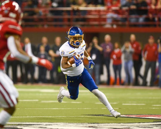 SDSU wide receiver Cade Johnson (15) runs the ball during the game against USD on Saturday, Nov. 23, 2019, at the DakotaDome in Vermillion.