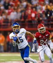 SDSU wide receiver Cade Johnson (15) runs the ball down the field during the game against USD on Saturday, Nov. 23, 2019, at the DakotaDome in Vermillion.