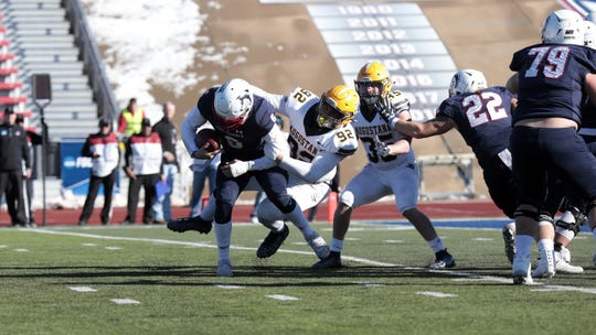 Augustana's Nate Meredith brings down CSU-Pueblo's Jordan Kitna during Saturday's playoff game