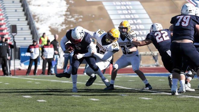 Augustana's Nate Meredith brings down CSU-Pueblo's Jordan Kitna during Saturday's playoff game