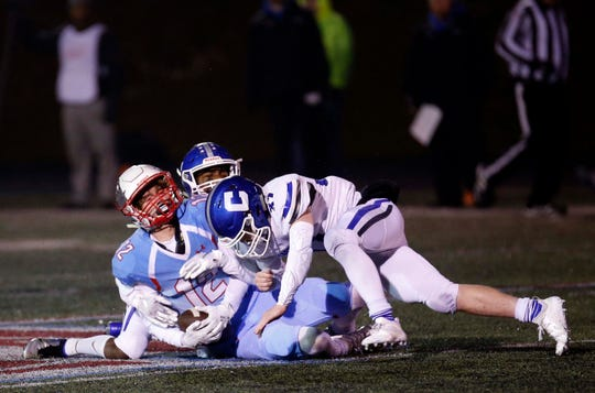 Glendale Falcons wide receiver Ben Shoemaker gets sandwiched between two defenders. He left the game with a concussion while Falcons head coach Mike Mauk argued the lack-of-call and was ultimately ejected.