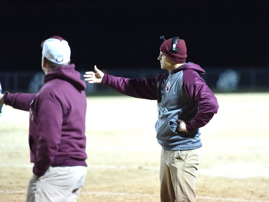 Stuarts Draft coach Nathan Floyd works the sidelines in the Region 2B semifinals Friday night, November 22.