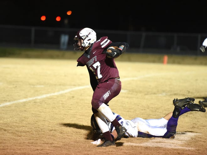 Stuarts Draft's Kasey Branch breaks free for a 51-yard touchdown reception in the first half in the Region 2B semifinals Friday night, November 22.
