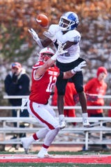 Jacolby Maxwell of Aurora leaps over Ryan LaCasse of St. John's to make a touchdown catch during the first half of the Saturday, Nov. 23, 2019, game at Clemens Stadium in Collegeville.