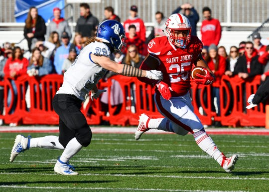 Kai Barber rushes for St. John's during the first half of the Saturday, Nov. 23, 2019, game against Aurora University at Clemens Stadium in Collegeville.