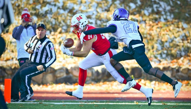 Jack Kemper makes a catch for a touchdown for St. John's during the first half of the Saturday, Nov. 23, 2019, game against Aurora University at Clemens Stadium in Collegeville.