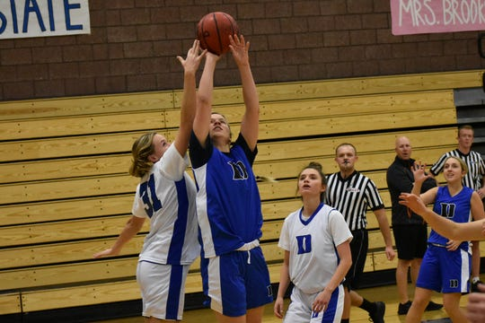 Dixie girls basketball practices during an inter-squad scrimmage.