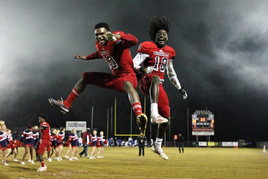Wakulla senior defensive backs DeJuan Hughes (10) and Quez Allen (18) celebrate after Wakulla beat Godby 28-0 in a Region 1-5A final on Friday, Nov. 22, 2019.
