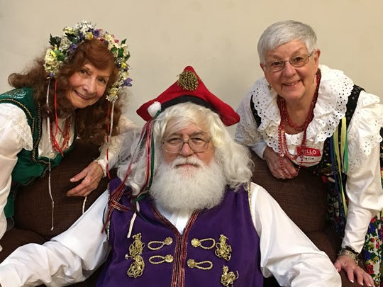 Traditionally, St. Nicholas hands out gifts to the children on Dec. 7., not on the 25th. As the Wigilia this year falls on the 7th, St. Nicholas will be present. He is seen here at a past celebration with Martha Saconchik-Pytel on left and Phyllis Kupiszewski.