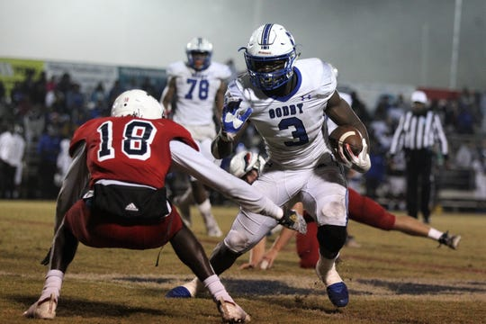 Godby senior running back Jaquez Yant tries to make a move on Wakulla defensive back Quez Allen as Wakulla beat Godby 28-0 in a Region 1-5A final on Friday, Nov. 22, 2019.