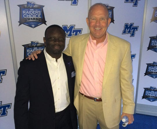 Kortne Gosha poses with Middle Tennessee State football head coach Rick Stockstill.