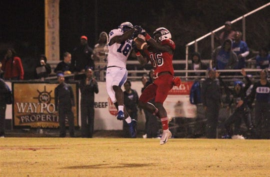 Wakulla sophomore defensive back Denzel Miller makes an interception as Wakulla beat Godby 28-0 in a Region 1-5A final on Friday, Nov. 22, 2019.