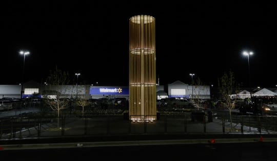 The Walmart shooting memorial lights up Friday, the night before it's dedication ceremony.
