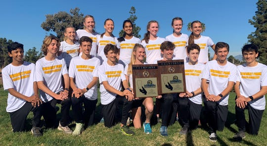The Newbury Park boys and girls cross country teams pose with their championship plaques after both teams won the CIF-SS Division 2 titles Saturday in Riverside.