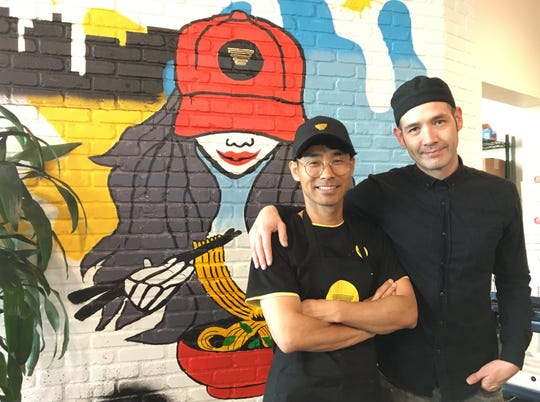 """Silverlake Ramen founding executive chef Thomas Aono, right, poses with franchisee Jinsu """"Jimmy"""" Kim at the restaurant's location inside The Annex at The Collection at RiverPark in Oxnard."""