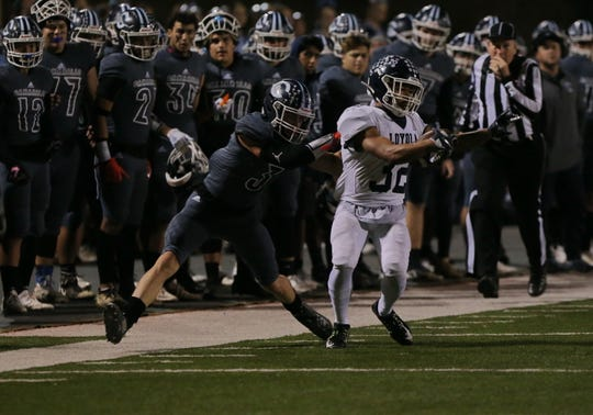 Camarillo High's Taj Flaaten brings down Loyola's Harrison Allen during the second quarter of Friday night's CIF-SS Division 4 semifinal game at Moorpark College. Camarillo lost, 31-14.