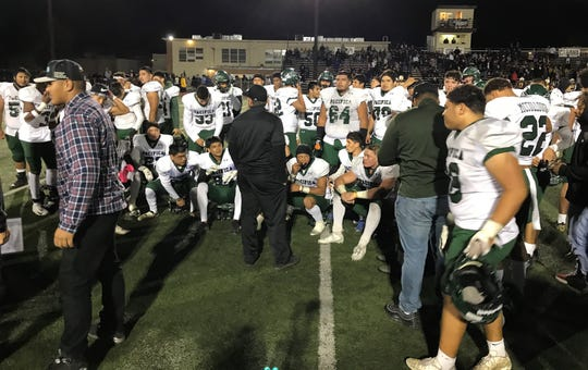 Head coach Mike Moon talks to his Pacifica High football team after the Tritons beat host Crespi 37-10 on Friday night to advance to the CIF-SS Division 6 championship game.