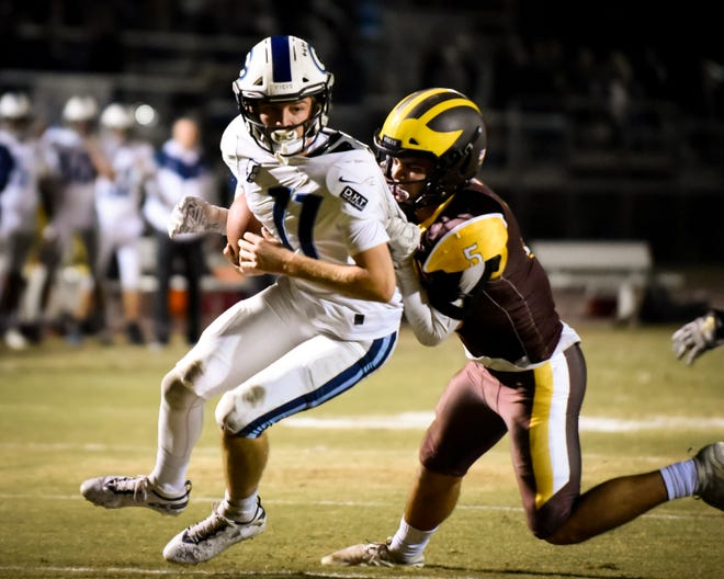 Central Valley Christian's Tyce Griswold runs the ball against Golden West in a Central Section Division III semifinal football game  at Visalia Community Stadium Friday, Nov. 22, 2019.