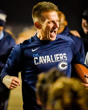 Central Valley Christian head coach Mason Hughes celebrates victory in a Central Section Division III semifinal football game  at Visalia Community Stadium Friday, Nov. 22, 2019.