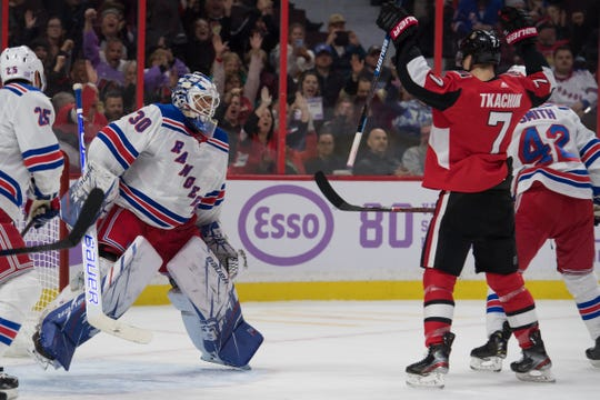 Nov 22, 2019; Ottawa, Ontario, CAN; New York Rangers goalie Henrik Lundqvist (30) reacts as Ottawa Senators left wing Brady Tkatchuk (7) celebrates a goal scored by left wing Anthony Duclair (10-not pictured) in the second period at the Canadian Tire Centre. Mandatory Credit: Marc DesRosiers-USA TODAY Sports