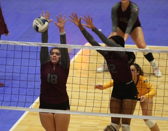 Valhalla's Stephanie Sicilian (17) and Jasmine Grant (12) put up a block during the opening round of the NYSPHSAA Girls Volleyball Championships against Lake George at Cool Insuring Arena in Glens Falls on Saturday, November 23, 2019.