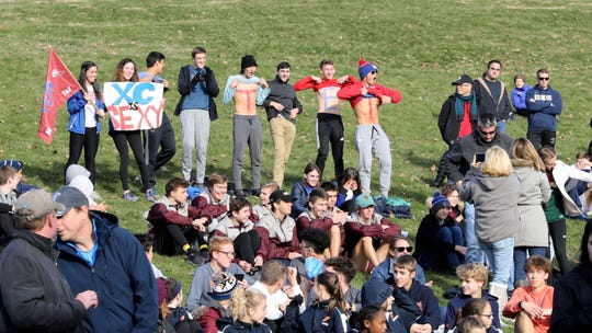 A group show their support for Carmel's Katie Turk after the girls New York State Federation Cross-Country Championships at Bowdoin Park in Wappingers Falls, Nov. 23, 2019.